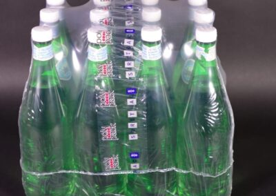 shrink wrapped large bottles with a handle wrap